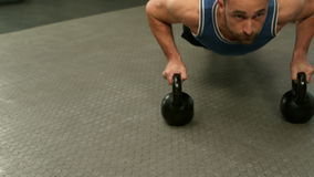 Fit man exercising with kettlebell stock footage