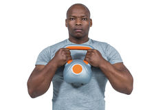 Fit man exercising with kettlebell Stock Photos