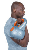 Fit man exercising with kettlebell Royalty Free Stock Photo