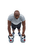 Fit man exercising with kettlebell Stock Photo