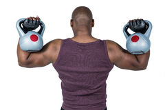 Fit man exercising with kettlebell Stock Images