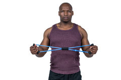 Fit man exercising with resistance band Stock Photos