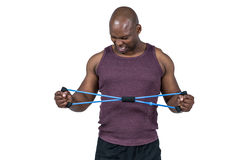 Fit man exercising with resistance band Stock Photo