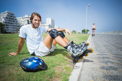 Fit man getting ready to roller blade Stock Image