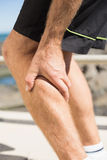 Fit man gripping his injured calf muscle Stock Image