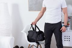 Fit man with gym bag. Going on the workout Royalty Free Stock Photography
