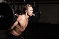 Fit man in gym lifting weights Royalty Free Stock Image