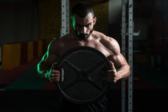 Fit Man Holding Weights In Hand Royalty Free Stock Photo
