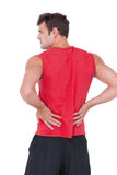 Fit man with injured back Royalty Free Stock Photo