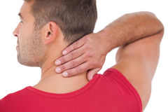 Fit man with injured neck Royalty Free Stock Images