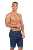 Fit Man In Jeans Shorts Showing Thumb Up Stock Images