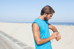 Fit man jogging on promenade Royalty Free Stock Images