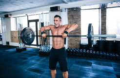 Fit man lifting barbell Royalty Free Stock Photo