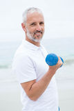 Fit man lifting dumbbells Stock Images