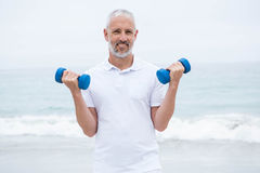 Fit man lifting dumbbells Royalty Free Stock Images