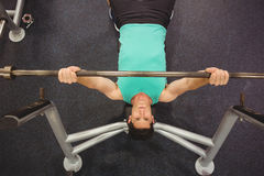 Fit man lifting heavy barbell Stock Photo