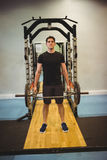 Fit man lifting heavy barbell Royalty Free Stock Photo