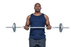 Fit man lifting heavy barbell Royalty Free Stock Photography
