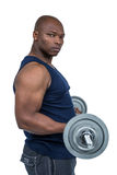 Fit man lifting heavy barbell Stock Photography