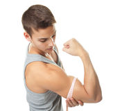 Fit man measuring his muscle biceps. Top view portrait of fit man measuring his muscle biceps isolated on white background Stock Images