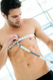 Fit man measuring his muscles Royalty Free Stock Images