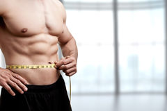 Free Fit Man Measuring His Waist Royalty Free Stock Photography - 81431807
