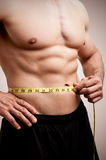 Fit Man Measuring His Waist Stock Images