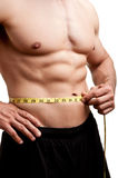 Fit Man Measuring His Waist Royalty Free Stock Photography