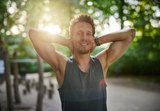 Fit Man at the Park with Hands Behind his Head Royalty Free Stock Images