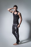 Fit man posing in jeans and shirt Stock Image