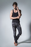 Fit man posing in jeans and shirt Royalty Free Stock Photo