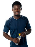 Fit man posing with water bottle Royalty Free Stock Photo