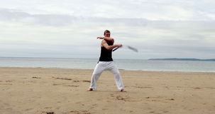 Fit man practicing martial arts