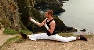 Fit man practicing martial arts stock footage