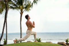 Fit man practicing  yoga Stock Photography