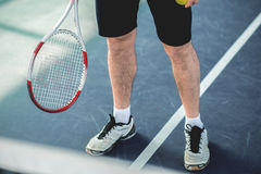 Fit man is ready to play tennis Stock Image