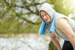 Fit man resting after jogging. Stock Images