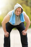 Fit man resting after jogging. Royalty Free Stock Photos