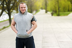 Fit man resting after run listening music. Stock Photo