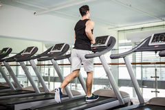 Fit man running on treadmill Stock Photography