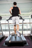 Fit man running on treadmill Royalty Free Stock Images