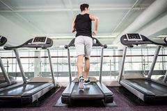 Fit man running on treadmill Stock Photo