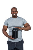 Fit man scooping protein powder Royalty Free Stock Photography