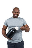 Fit man scooping protein powder Stock Images