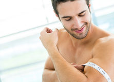 Fit man showing his muscles Stock Image