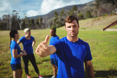 Fit man showing thumbs up in bootcamp Royalty Free Stock Photography