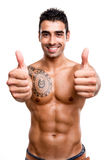 Fit man showing thumbs up Stock Images
