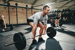 Free Fit Man Smiling During A Gym Weightlifting Class Stock Images - 144410314