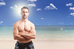 Fit Man Standing With Arms Crossed Royalty Free Stock Images