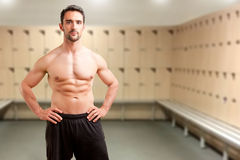 Fit Man Standing With Arms At His Waist Stock Photography